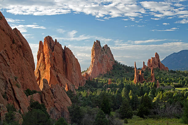 Blue skies with clouds over  Garden of the Gods Blue skies with clouds over lookout view of Garden of the Gods national forest stock pictures, royalty-free photos & images