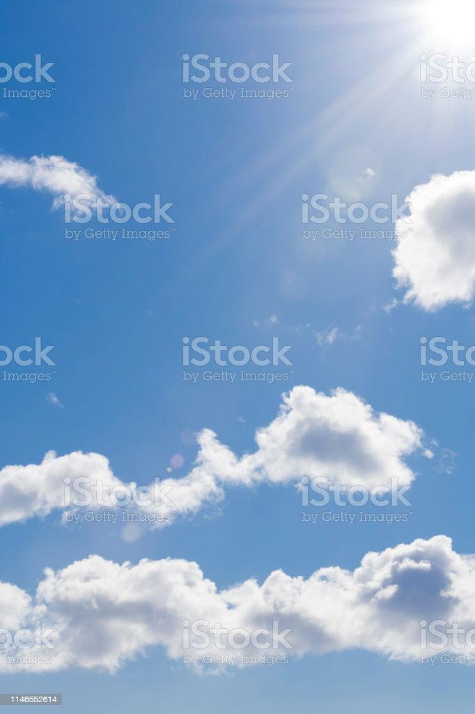 A cloudscape at a sunny day in spring with a deliberate, real lens...