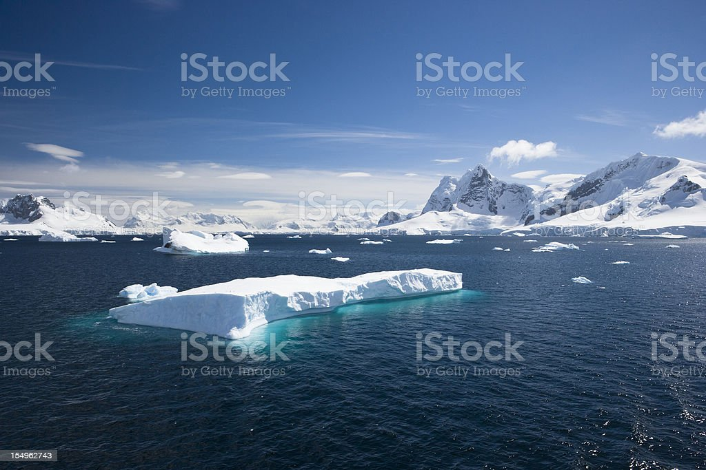 Blue sky above sea with icebergs stock photo