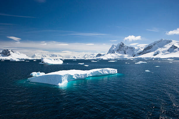 Blue sky above sea with icebergs stock photo