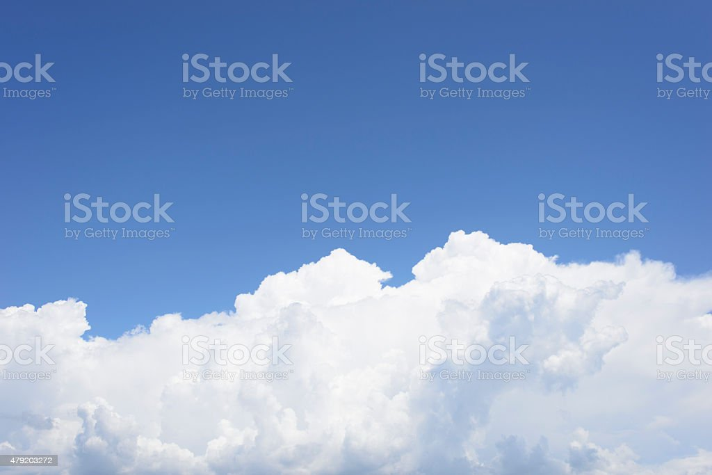 Blue Sky Above White Cumulus Clouds royalty-free stock photo