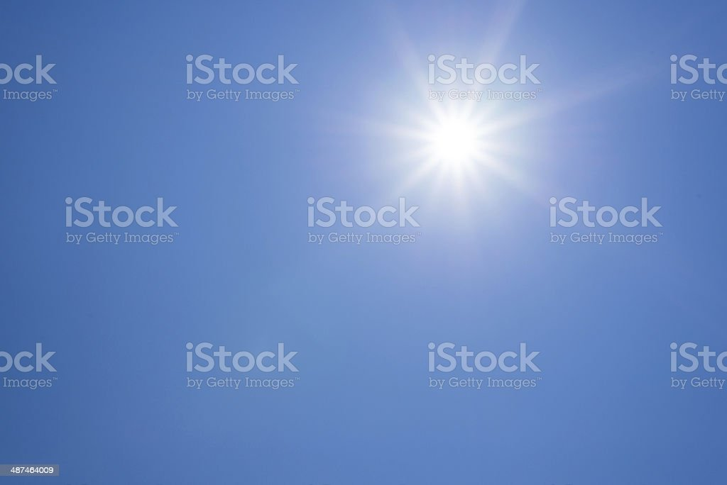 Blue sky against sun stock photo