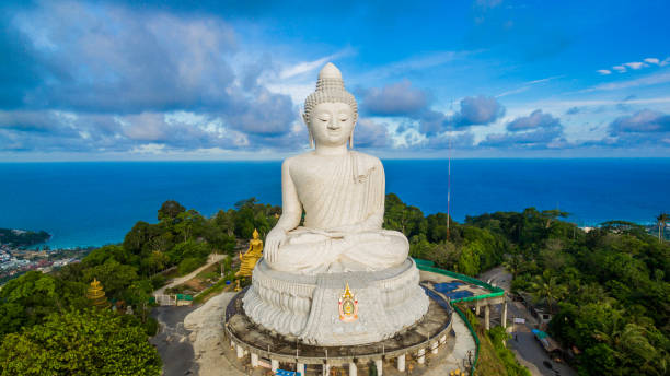 blue sky and blue ocean are on the back of phuket big buddha. - phuket stock photos and pictures