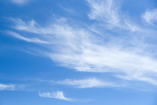 Blue sky and white clouds background with day light of summer, use for natural environment concept