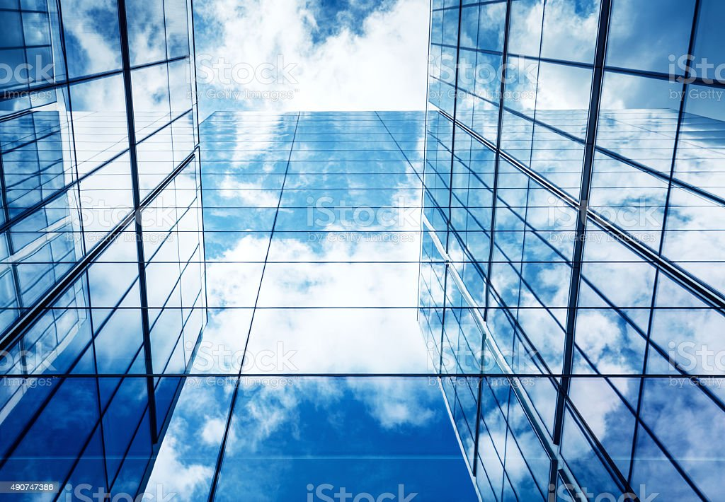 Blue Sky and Clouds Reflected in Modern Glass Architecture stock photo