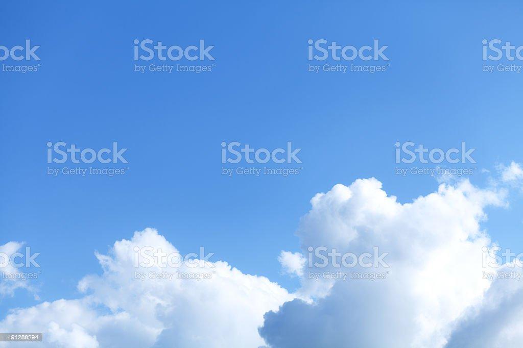 Blue sky and cumulus clouds stock photo