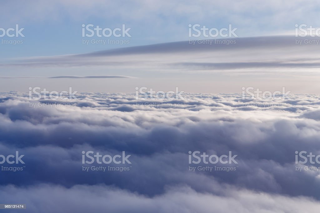Blue sky and different types of clouds - a typical view from the window of the plane, which is watched by passengers in flight zbiór zdjęć royalty-free