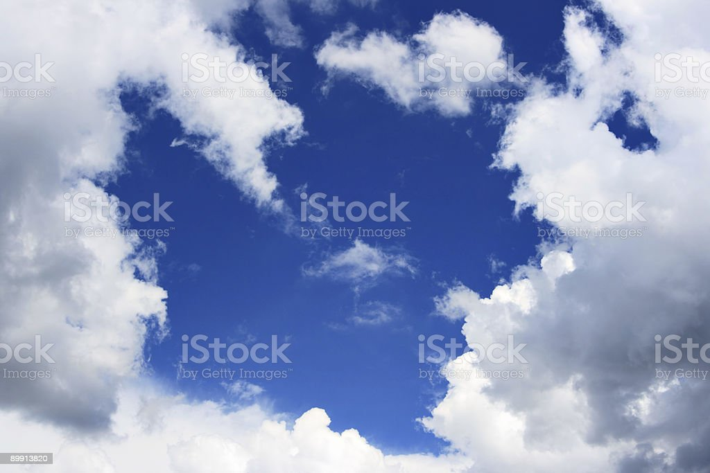 Blue sky and frame from clouds royalty-free stock photo