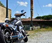June 2020 - Brussels - Belgium : Rear view of a grey motorcycle parked on the road side on a nice sunny day