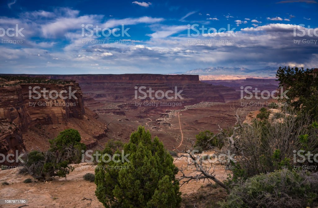 Blue Sky and Red Rocks in Shafer Canyon Overlook, Canyonlands National Park stock photo
