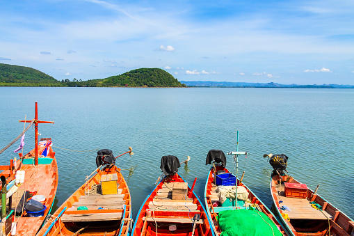 494377786 istock photo Blue sky and small boat 612624388