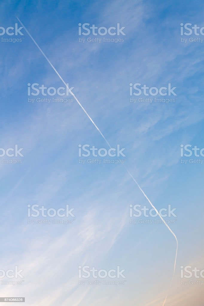 Blue Sky and Vapor Trail of the Plane stock photo