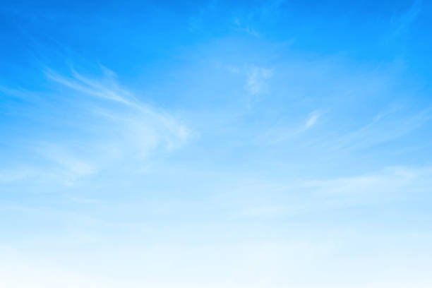 Blue sky and white clouds background stock photo
