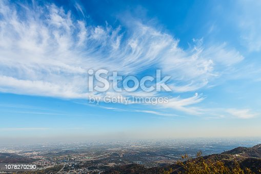 186849963 istock photo Blue sky and white clouds over the city 1078270290