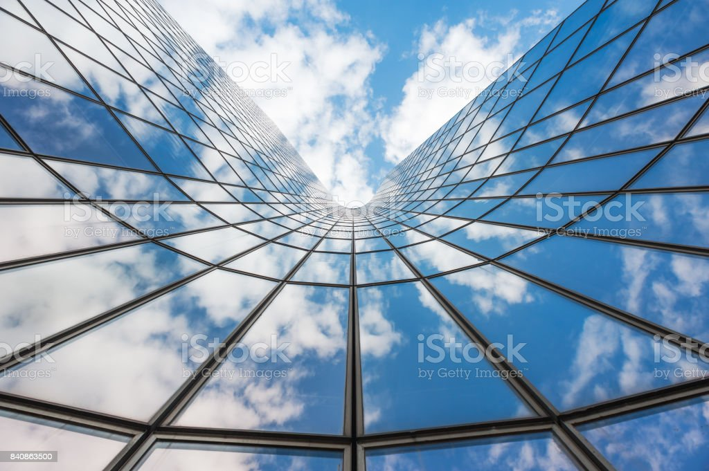 Blue sky and white clouds reflecting in a  glass buildin stock photo