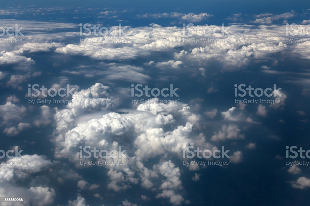 Blue sky and white clouds view from the airplane window stock photo