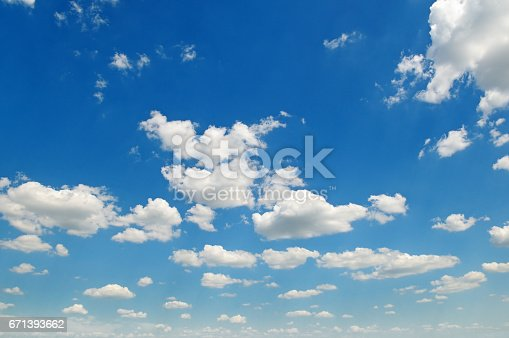 istock blue sky and white cumulus clouds 671393662