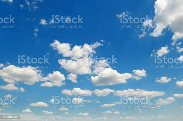 Photo of blue sky and white cumulus clouds