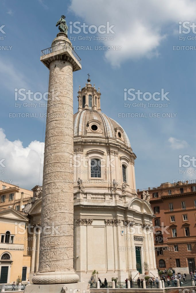 Blue sky and white puffy clouds over Trajan's Column stock photo