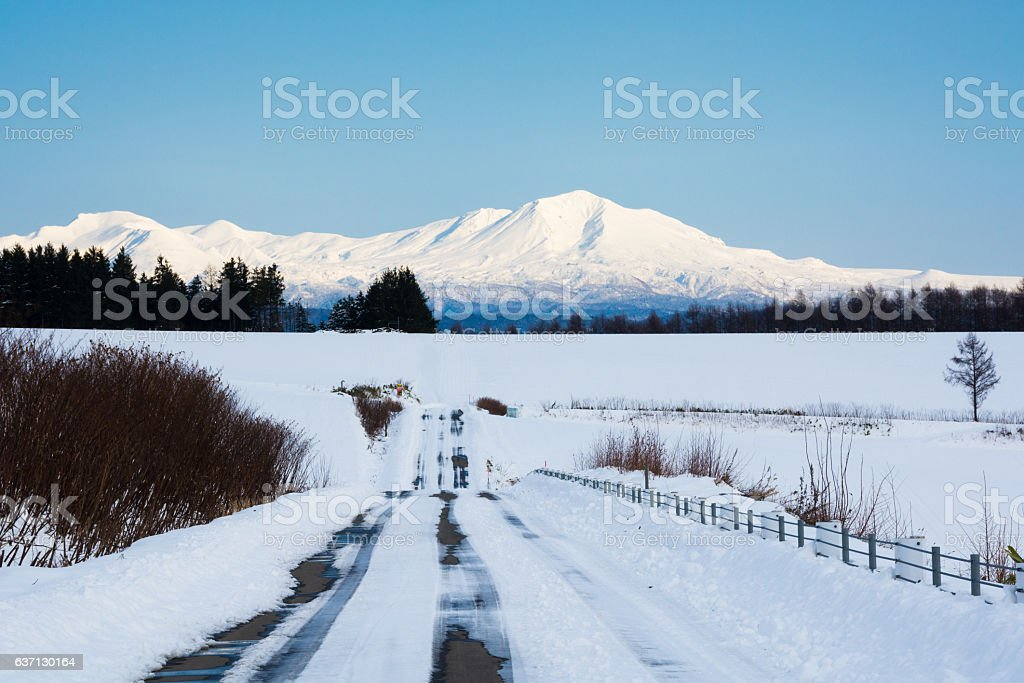 Blue sky and winter mountain range stock photo