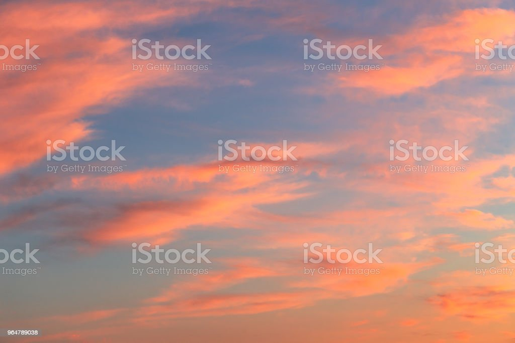 blue sky at sunset covered with red clouds royalty-free stock photo