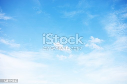 Blue sky background and white clouds soft focus, and copy space.