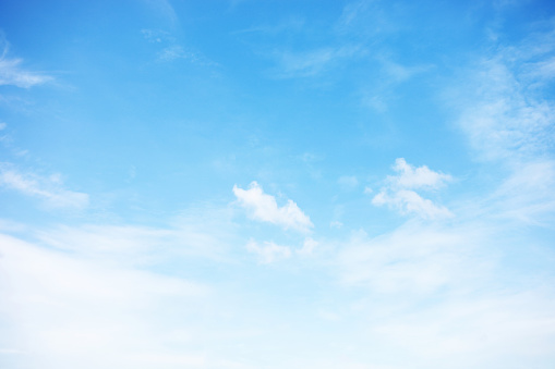 istock Blue sky background and white clouds soft focus, and copy space 1128410927