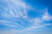 istock Blue sky background and white clouds soft focus 1221013709