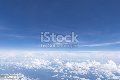 istock Blue sky background and white clouds soft focus.Aerial veiw landscape from airplane window. 1161006556