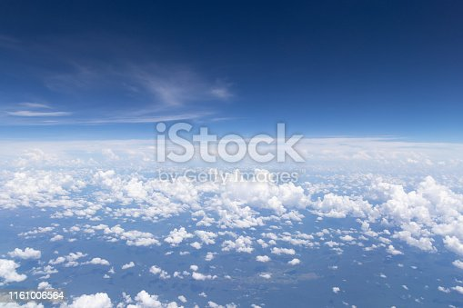 istock Blue sky background and white clouds soft focus.Aerial veiw landscape from airplane window. 1161006564