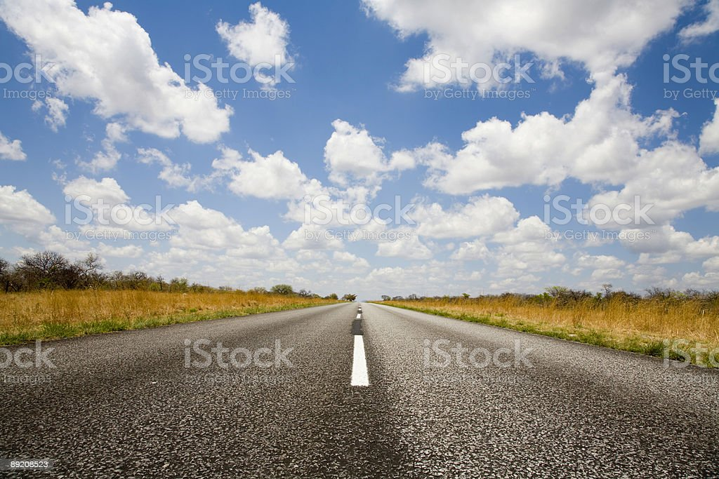 Blue sky beautiful weather and one road for a perfect ride royalty-free stock photo