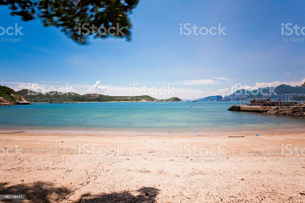 Blue sky blue sea - Sandy Beach stock photo