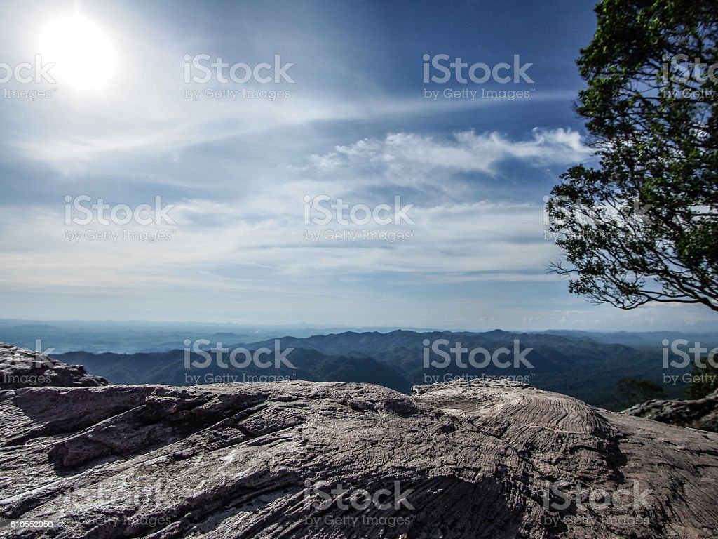 blue sky green tree and cliff with sunshine from thailand stock photo