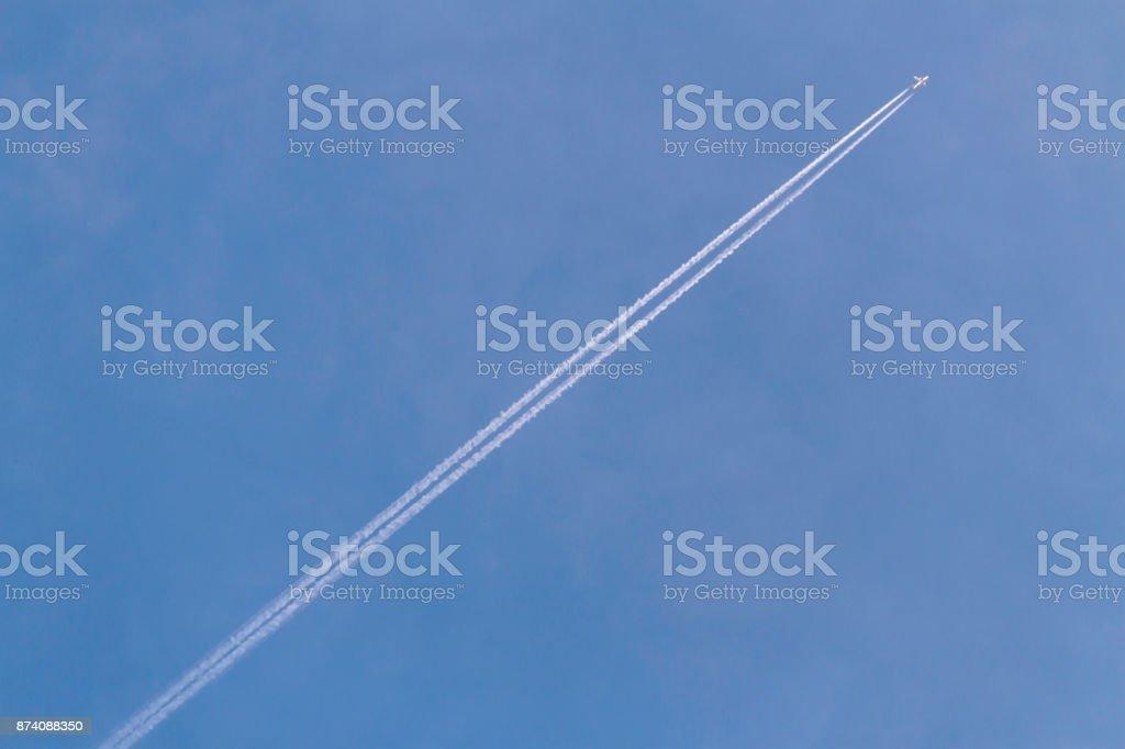 Blue Sky Jet and Vapor Trail stock photo