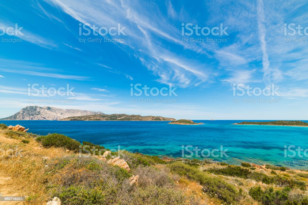 Blue sky over Capo Coda Cavallo - Royalty-free Beach Stock Photo