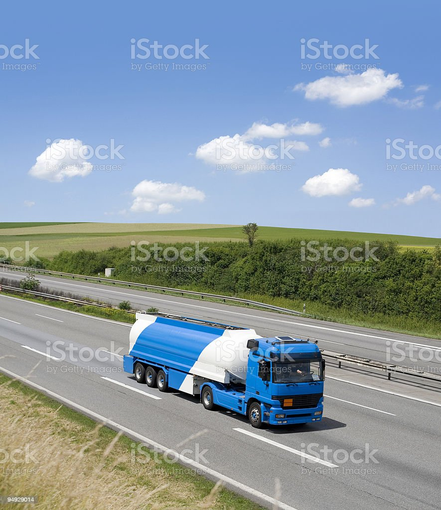 Blue sky over gasoline truck royalty-free stock photo