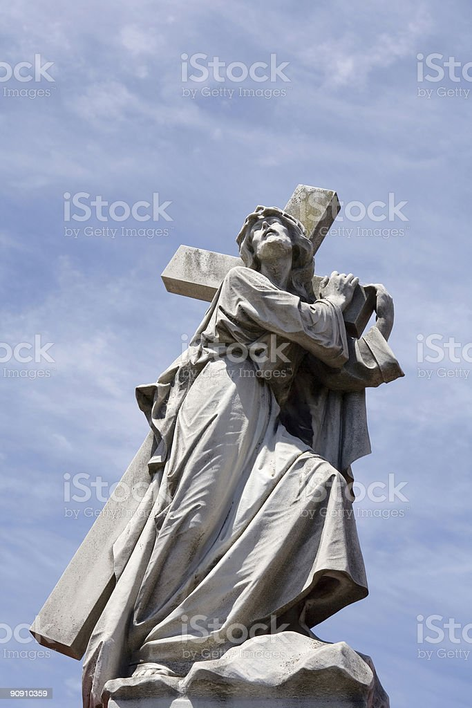 Blue sky over Jesus carrying the cross stock photo