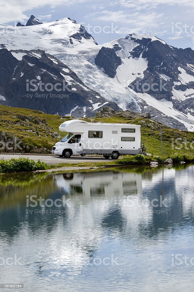 Blue sky over motorhome in the Alps royalty-free stock photo