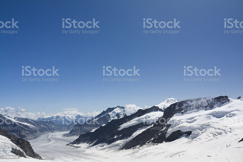 Blue sky over snow covered mountains royalty-free stock photo
