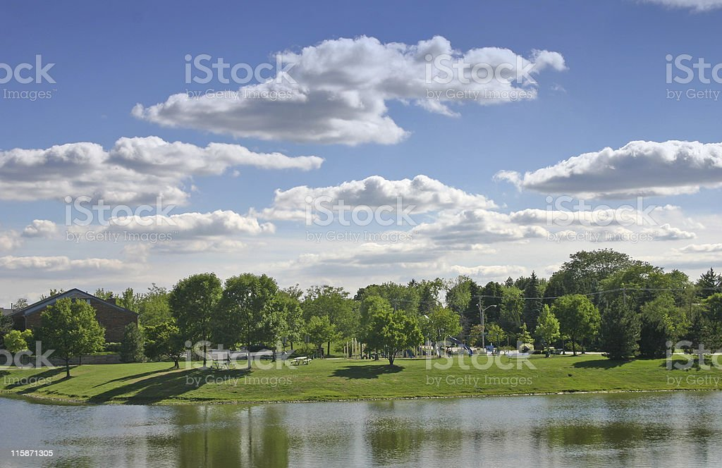 Blue Sky Over The Park with a pond royalty-free stock photo
