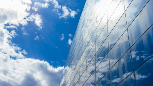 Blue sky reflected on a Glass building stock photo