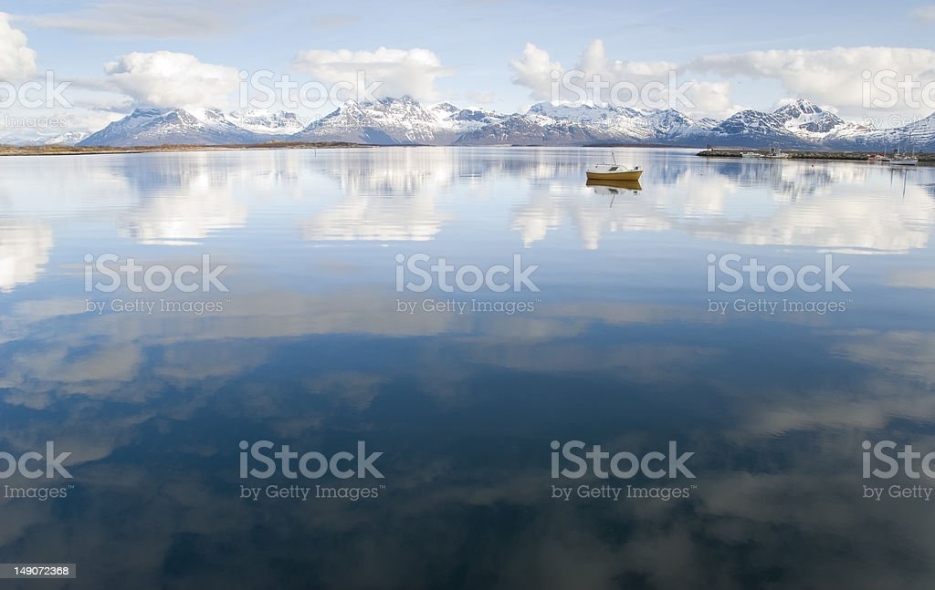 Blue sky reflections in still fjord water royalty-free stock photo