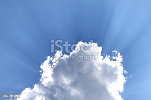 istock Blue sky sunlight behind cloud 660185150