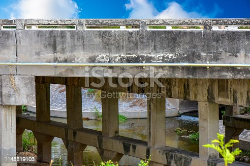 Old bridge over the Canal to factory. Reinforced concrete bridge for trucks running through the factory