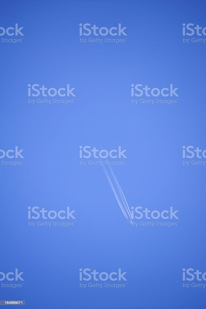 Blue sky with a long trail royalty-free stock photo
