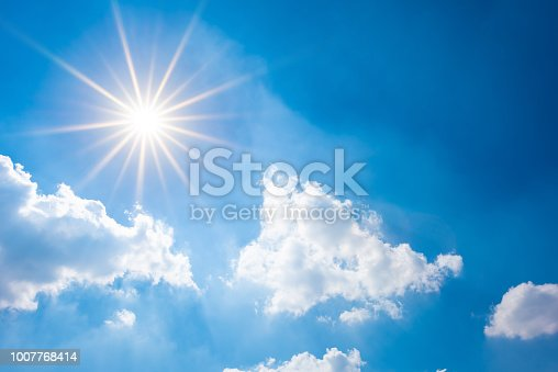 istock Blue sky with bright sun and clouds 1007768414