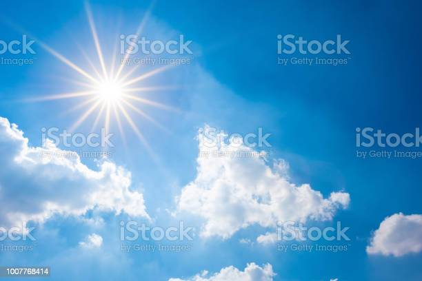 Photo of Blue sky with bright sun and clouds