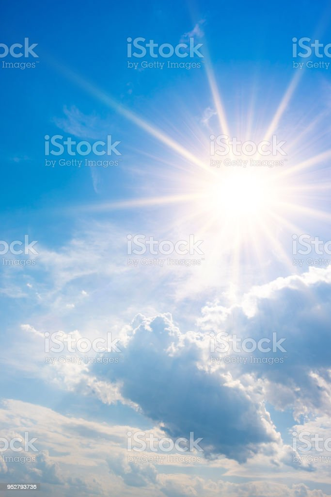 Blue sky with bright sun and clouds royalty-free stock photo
