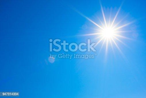 istock Blue sky with bright sun 947314334