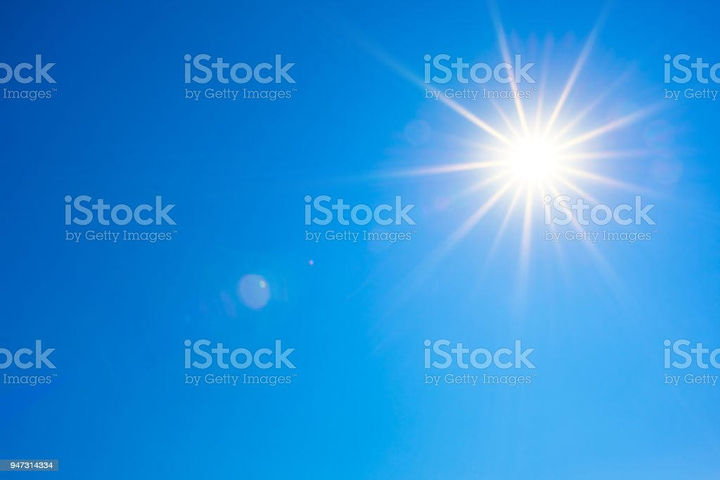 Blue sky with bright sun stock photo